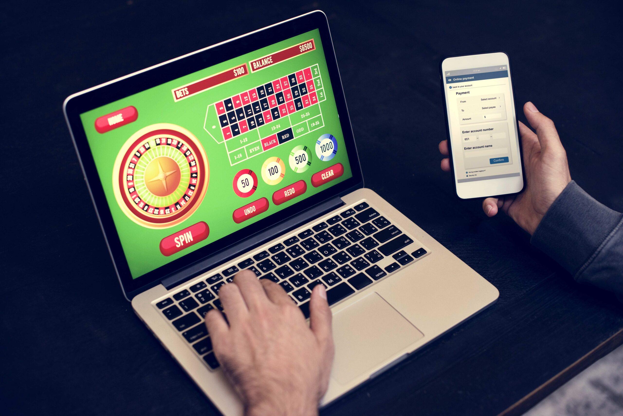 hand-holding-credit-card-playing-online-gambling-casino-slot-content-image