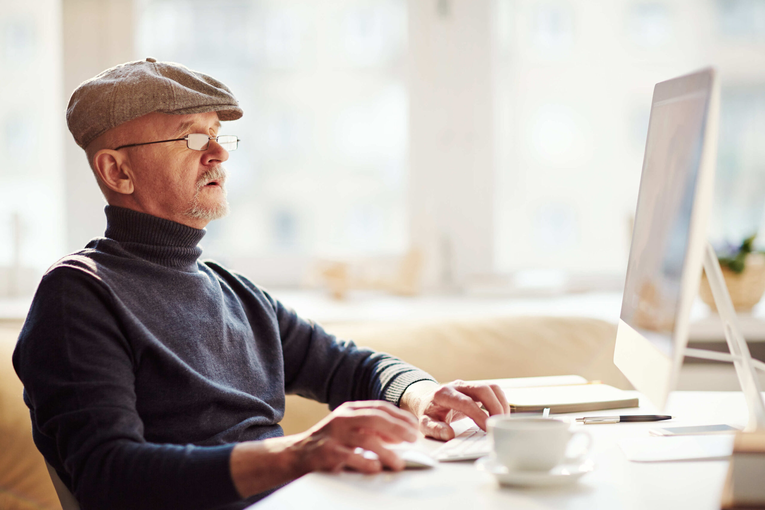 old-man-computing-soccer-odds-content-image